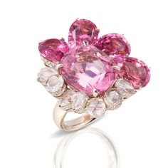 Pomellato's Pom Pom London pink tourmaline and diamond ring features a pink tourmaline of 13.93 carats surrounded by four slightly darker tourmalines and seven rose-cut diamonds with a carat total of 2.74. A further 3 carats of pavéd diamonds line the structure of the ring for added luxury. Discover more from the Italian jewellery brand at their London boutique store: http://www.thejewelleryeditor.com/shop/product/pomellato-pom-pom-london-pink-tourmaline-diamond-ring-in-white-gold/ #jewelry