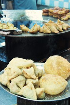 Lovely sight of freshly fried Samosa and Bhature, in Delhi.