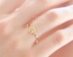 Solid 14K Gold Infinity knot ring Hug ring by IndulgentDesigns