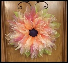 Dress up your door, porch, or wall with this beautiful deco mesh spring flower wreath by A Noble Touch. Ombre flower with a dark purple center. Measures about 25-28in around. Pictures do not do these justice. Please allow up to three weeks for wreath to be shipped. It will depend on if there are previous orders being filled. *****If you are purchasing this item and you are local to Marlette, MI area, you can type in LOCAL10 in the coupon section and the shipping wont be applied. You can then…