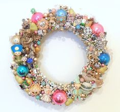 Christmas wreath loaded with vintage jewelry and ornaments