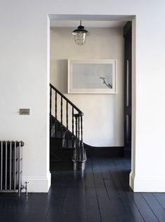 Dark floors & bannister.
