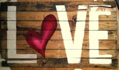 "The word ""LOVE"" one upcycled pallet boards with a red heart"