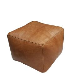 Cube | leather pouf Handcrafted from full grain natural leather by our artisan team in Morocco, the Cube poufhas richly beautiful texture that will make a stat