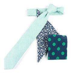Unexpected patterns of floral and polka dots balanced by a fine cotton stripe. Looks great with any suit in your wardrobe. www.TheTieBar.com