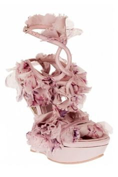 From spring '12, these Alexander McQueen floral shoes lacked a real heel, but made up for it with a choking swath of silk rosettes. Chalk it up to Sarah Burton to make florals seem malicious.