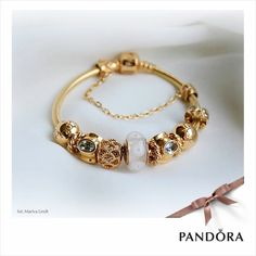 PANDORA All Gold Bracelet with Select Gold Charms.