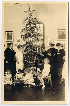 The imperial family of Austria celebrating Christmas. You can see the last empress of Austria, Zita on the right side, surrounded by her kids. After her husband's death in 1922, Zita only wore black clothes. This photo also shows the family in exile on Madeira. Photographed by H. Schuhmann, Vienna, Austria, around 1923.