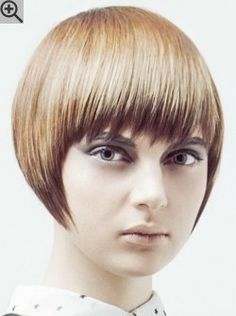 Short face framing bob cut with soft texturing and bangs. A contemporary style for brown hair.
