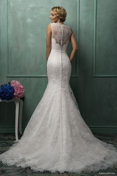 White lace, floral wedding dress.. The buttons all the way down the back are killing me. I NEED IT   allforthewedding