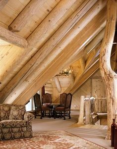Upper floor of a log home with accent log