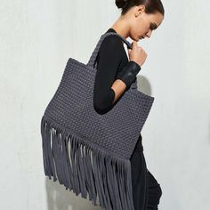 Paula Coles bags are sustainable, one of a kind items made of recycled cotton t-shirts. These bags are designed and woven by Haitian artisans. A dose of fringe