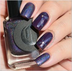 Purple floral nail art with a glitter twist.