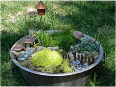 made a couple fairy gardens after being inspired!  A Southern Belle with Northern Roots: fairy garden