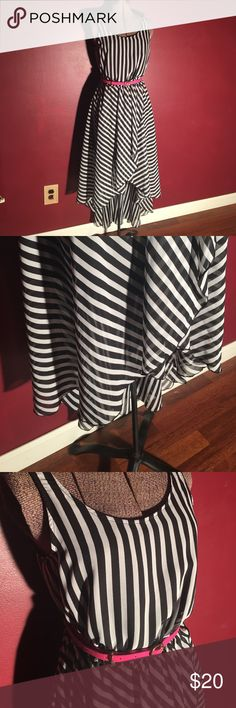 Elle Black & White striped high-lo dress small Elle high-low striped dress. Black and white stripes. It is in excellent used condition. I only wore it one time. It has Small belt loops that are not noticeable to hold the pink belt or any other you wish to wear with it. (Smaller skinny belts of course.) The belt is included. It also has a liner underneath. As pictured. No tag telling me what the material is. If you want measurements or any questions feel free to drop a comment below. 👇🏻…