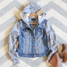 A must-have for the season. A soft worn denim pairs with heather gray sweatshirt knit sleeves and hood. Button-up front with side pockets for the coziest fit. - Color: Denim & gray - 65% Cotton & 35%