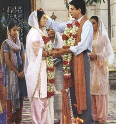 Rahul Raichand (Shahrukh Khan) and Anjali Sharma (Kajol) marrying in Kabhi Khushie Kabhie Gham (2001)