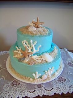 Alli's birthday cake. Gumpaste seashells, royal icing coral and brown sugar was mixed with organic sugar to make the sand. This cake was inspired by Shirley Wilson's beautiful beach themed cakes.