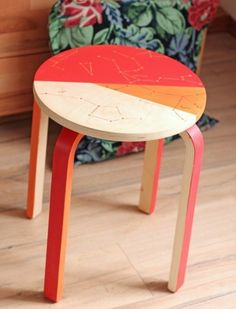 I love the bright colors painted onto this basic IKEA stool - and the constellation pattern. What a fun way to liven up our entryway, maybe tucked under the console table?