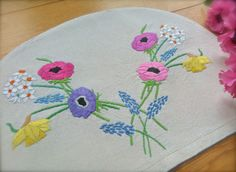 Check out this item in my Etsy shop https://www.etsy.com/uk/listing/503704883/hand-embroidered-spring-flowers-vintage