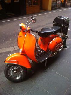 Orange vintage Vespa in Melbourne (via boysandvespas)