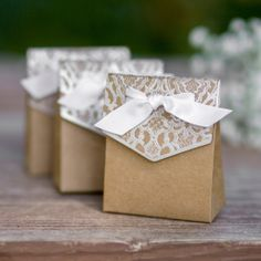 Add a bit of classic vintage flair to your venue with this adorable kraft, tent-style wedding party favor box with a lovely silver foil lace print design. When using with candies and edibles use wrapp