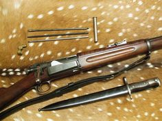Spanish American War Era .30-40 Krag Jorgensen. This is the rifle that composes the crossed rifles on the Marine Corps rank insignia from Lance Corporal to Master Sergeant.