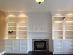Monogram Interior Design - Custom full wall built-in bookcases with TV mount over fireplace. New gas fireplace with stone mosaic surround - Beaverton, OR, United States