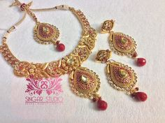 Beautiful Studded Semi Bridal Polki set. Intricate Designs on Golden Background with clear Polki and Red Stones... Truly Feminine!!!
