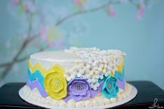 Spring purple teal and yellow chevron flower cake made by me, SweetEms Cakery. Photo credit: Ks photography