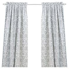 Topstitched cotton window panel with a rod pocket design and damask-inspired motif. Made in Council Bluffs, Iowa.  Product: Curtain panelConstruction Material: 100% CottonColor: Grey and whiteFeatures:  Topstitched Made in Council Bluffs, Iowa  Cleaning and Care: Hand or spot Clean