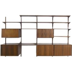 Rosewood Cado Wall Storage System | From a unique collection of antique and modern shelves at http://www.1stdibs.com/furniture/storage-case-pieces/shelves/