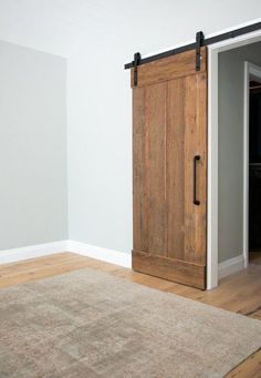Our Classic Flat Track Sliding Barn Door Hardware is our most popular barn door hardware kit, and it's easy to see why. It fits right in to modern decor as well as traditional farmhouse style spaces. Barn Door Closet, Diy Barn Door, Sliding Barn Door Hardware, Hanging Sliding Doors, Barn Doors For Closets, Barn Door In Bedroom, Sliding Door Closet, Farm Door, Barn Style Sliding Doors