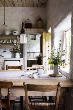 love this modern rustic country farmhouse kitchen dining room with reclaimed wooden cupboards, rustic wooden table, open shelves, rustic white-washed walls and tiled floor. Click through for more modern rustic farmhouse interiors ideas you'll love Country Kitchen Farmhouse, Farmhouse Interior, Modern Farmhouse, Kitchen Rustic, English Cottage Kitchens, Kitchen Modern, Vintage Farmhouse, Farmhouse Blogs, Reclaimed Kitchen