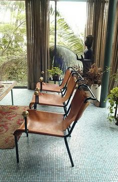 Lina Bo Bardi - leather sling chairs with brass ball hand-rests