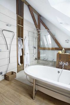@CheviotProducts is a fan of the wood floor in this lovely bathroom.