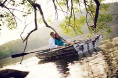 Engagement photo of couple paddling in a row boat at Maplewood State Park in Northwest Minnesota.