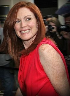 Julianne Moore looking fab in a bright red top.