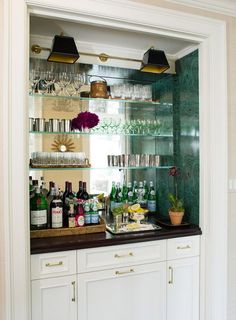 Wet Bar Mirror Backsplash - Design photos, ideas and inspiration. Amazing gallery of interior design and decorating ideas of Wet Bar Mirror Backsplash in dining rooms, kitchens by elite interior designers. Closet Bar, Hall Closet, Basement Closet, Closet Nook, Entry Closet, Basement Ceilings, Basement Bars, Basement Kitchen, Laundry Closet