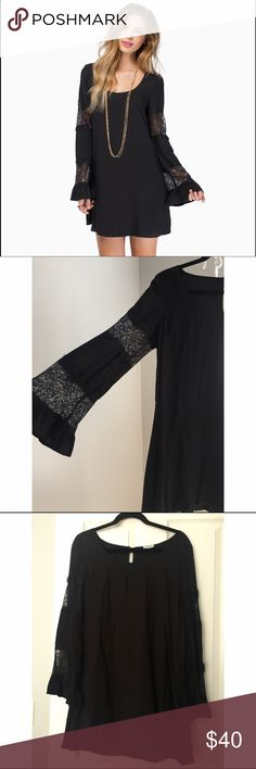 """Black Belle Lace Dress Long sleeve shift dress with scoop neck, bell sleeves, lace insets on the sleeve, and back keyhole closure.                                                 Size large     Fits a size 8-10                                           Bust 38-39 Waist 30-31 Hip40-41                                                      Length: 32""""/81.3cm Sleeve Length:24""""/61cm                                      Polyester lining. It is in excellent condition Tobi Dresses Mini"""