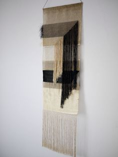 Gold and black woven wall hanging. Weaving by justine ashbee for native line.