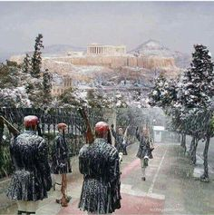 The Acropolis of Athens on a snowy day along with the national guards.