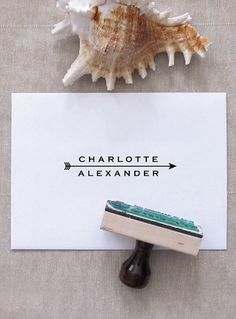 Custom stamps are a great idea for personalizing different aspects of your wedding, from favors, to thank you cards, to menus. Arrow Name Stamp - Custom Stamp for Stationery by Pretty Chic