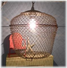 upcycled bait cage pendant light 2 Creative Lighting Project: An Upcycled Bait Basket Pendant Light Upcycled Crafts, Upcycled Vintage, Vintage Metal, Repurposed, Cage Pendant Light, Cage Light, Pendant Lamp, Industrial Chandelier, Rustic Lamps