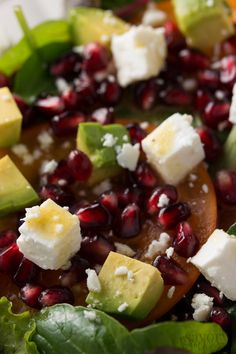 Make your holiday dinner table even more festive with this colorful winter salad. It's packed with seasonal flavors like persimmons and pomegranate, paired with buttery avocado and salty feta cheese. The orange and hazelnut dressing is outstanding! | savorynothings.com