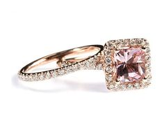 Rose Gold Morganite Diamond Engagement Ring Set - One of the most beautiful sets we've ever posted is this glamorous Rose Gold Morganite Diamond Engagement Ring Set stamped in 18k Rose Gold placed within a Prong setting featuring a Morganite Cushion cut center stone along with White Round cut accent sides stones along the mount & shank. The Rose Gold Morganite Diamond Engagement Ring Set has a total gem weight of 1.87 carats with an SI in clarity. #unusualengagementrings