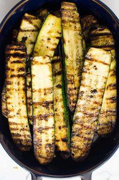 This easy Grilled Zucchini recipe requires just 5 ingredients (salt, pepper, and oil included!) and 20 minutes - for simple garlicky, lightly charred zucchini that can be made year-round. It's the perfect side dish for potlucks, BBQs, and grill season! Zucchini Dinner Recipes, Grilled Zucchini Recipes, Snack Recipes, Cooking Recipes, Grill Recipes, Snacks, Grilled Side Dishes, Potluck Side Dishes, Veggie Dishes