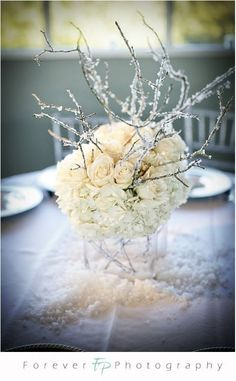 I like this very much, modern meets vintage(y) with the ivory roses and then the crystal on the branches. Nice.