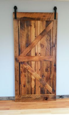 Sliding Barn Door made out of our authentic reclaimed barn wood. Rustic Blend texture with an amber finish.