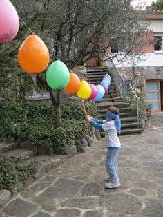 backyard party  pinata alternative - could be fun to put water in them for a summer party!